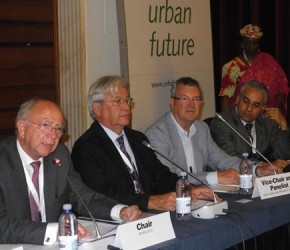 Götz emphasises the Role of Cities in the presence of Executive Director Clos (UN-Habitat).