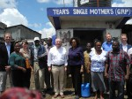 Peter Götz and the Chief Executive Officer of the Water Services Trust Fund, Eng. Jaqueline Musyoki (center), together with representatives of KfW, GIZ and African partners at a water supply kiosk in Mathare Village, Nairobi.